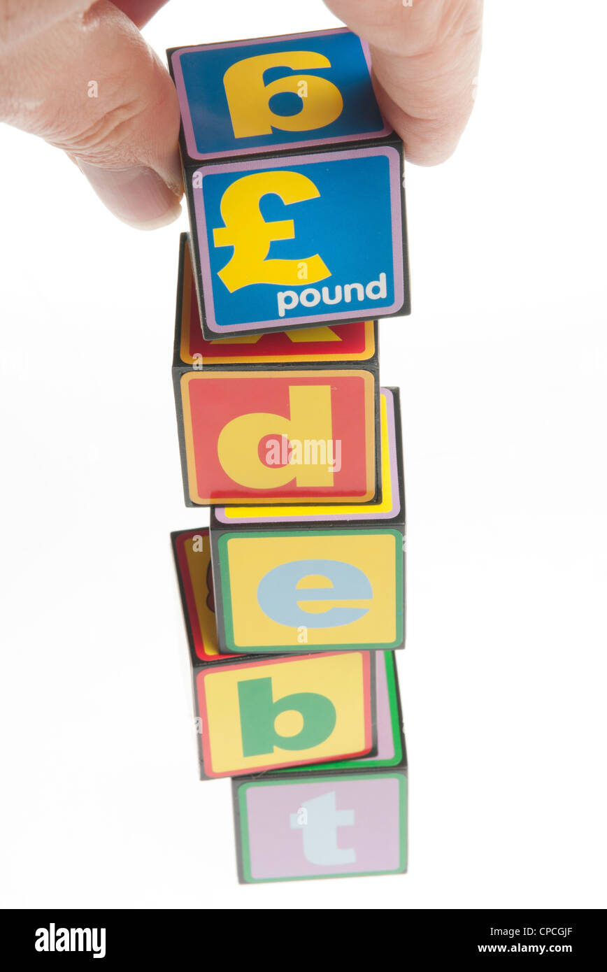 debt concept with toy building blocks - Stock Image