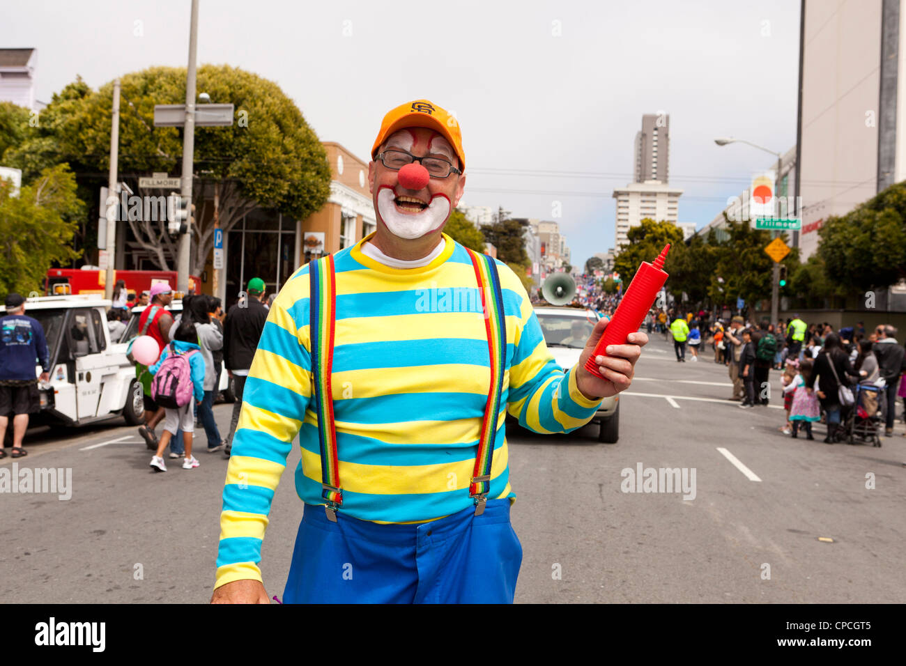 Kenny the Clown at a parade - Stock Image