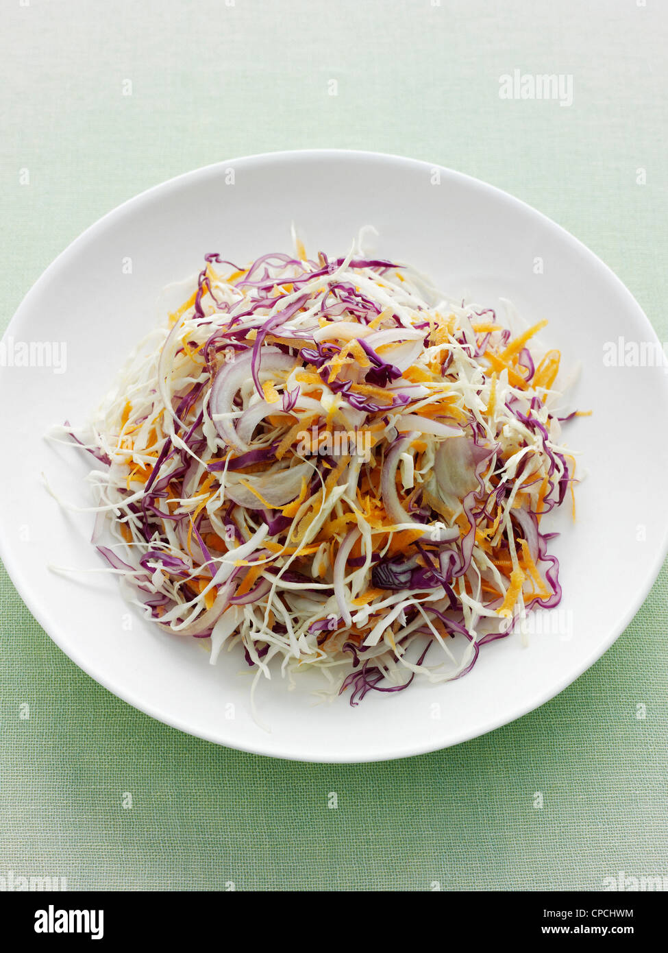 Plate of shredded cabbage and carrot - Stock Image
