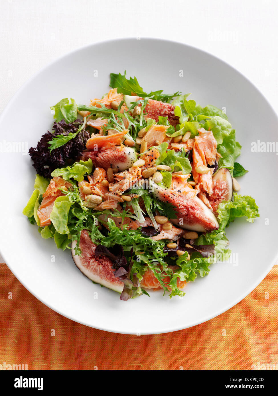 Plate of fish and fig salad - Stock Image