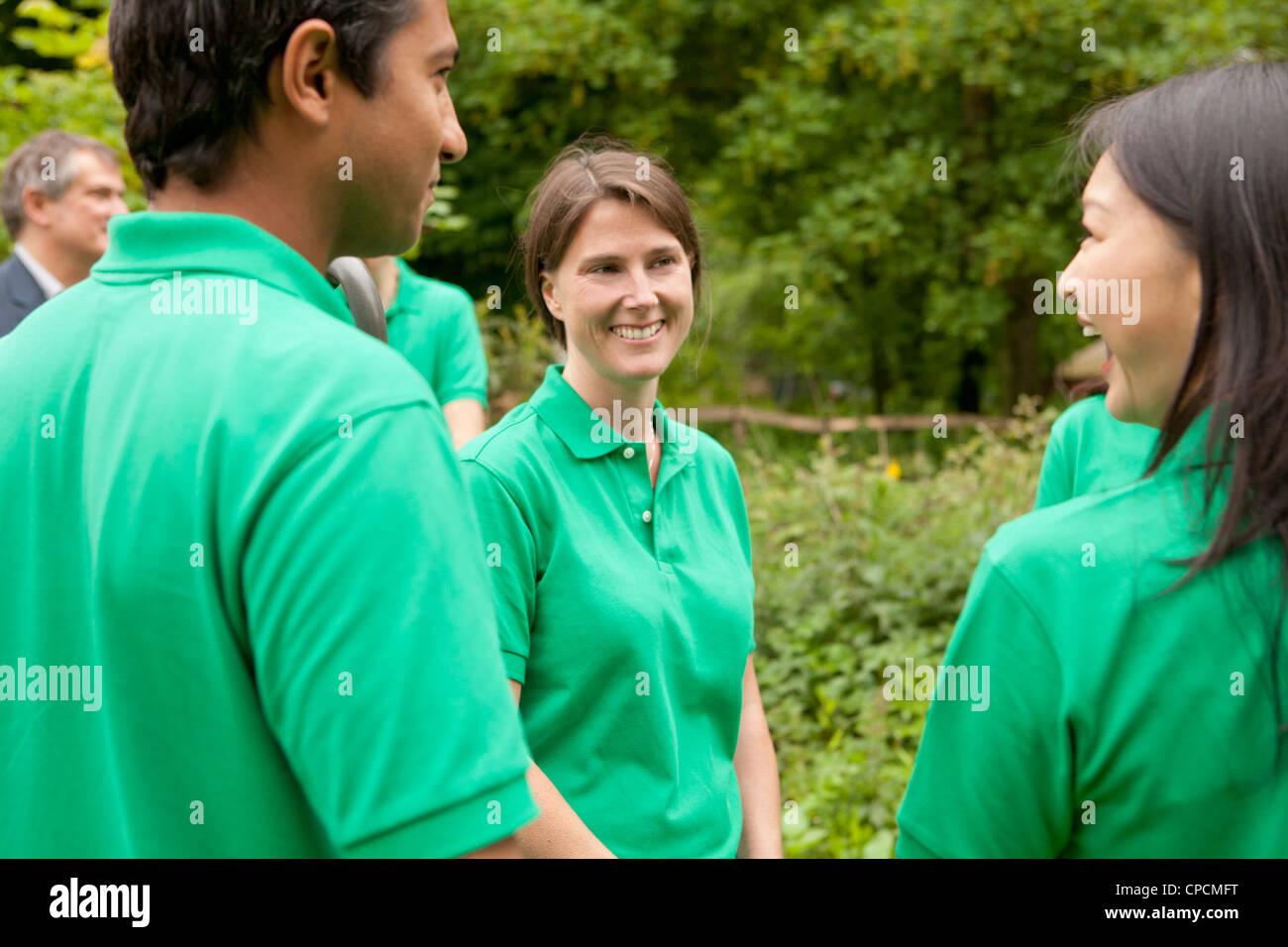 Gardeners talking in park - Stock Image