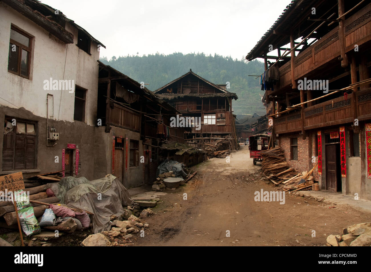 An unpaved street of a Dong people village, Southern China - Stock Image