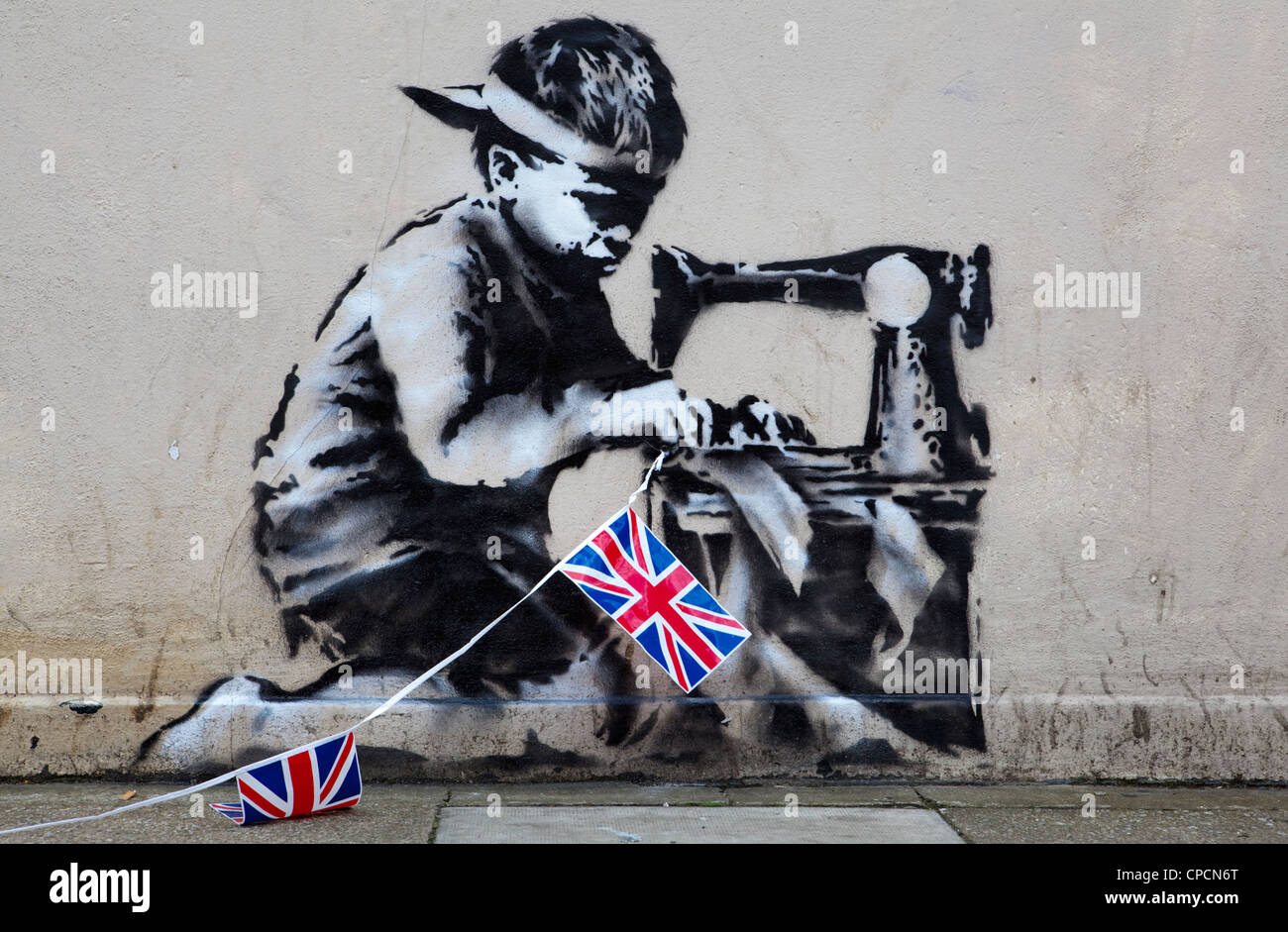 The work 'Slave Labour' from Graffiti Artist Banksy, London UK - Stock Image