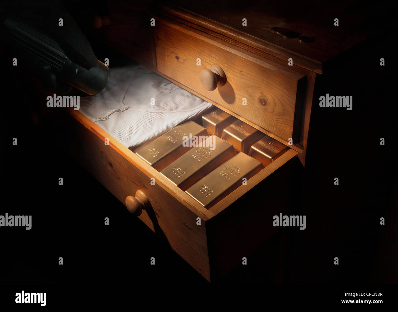 Gold bars in dresser drawer - Stock Image