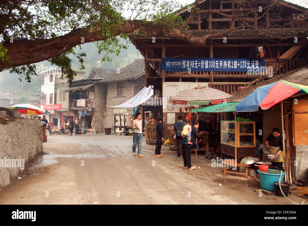 Busy street of a Dong people village, Southern China - Stock Image