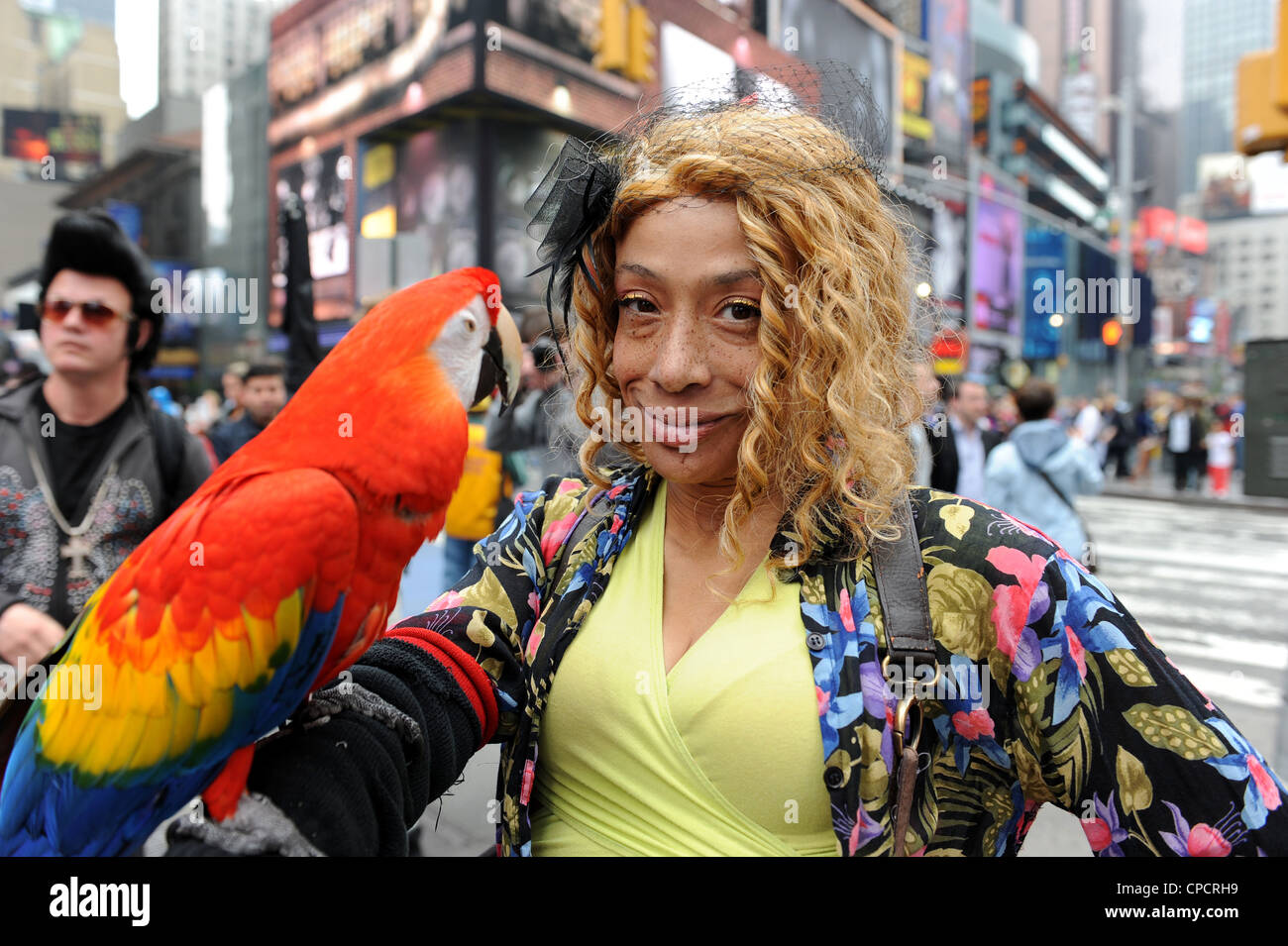 Entertainer with her Parrot in Times Square, New York - Stock Image