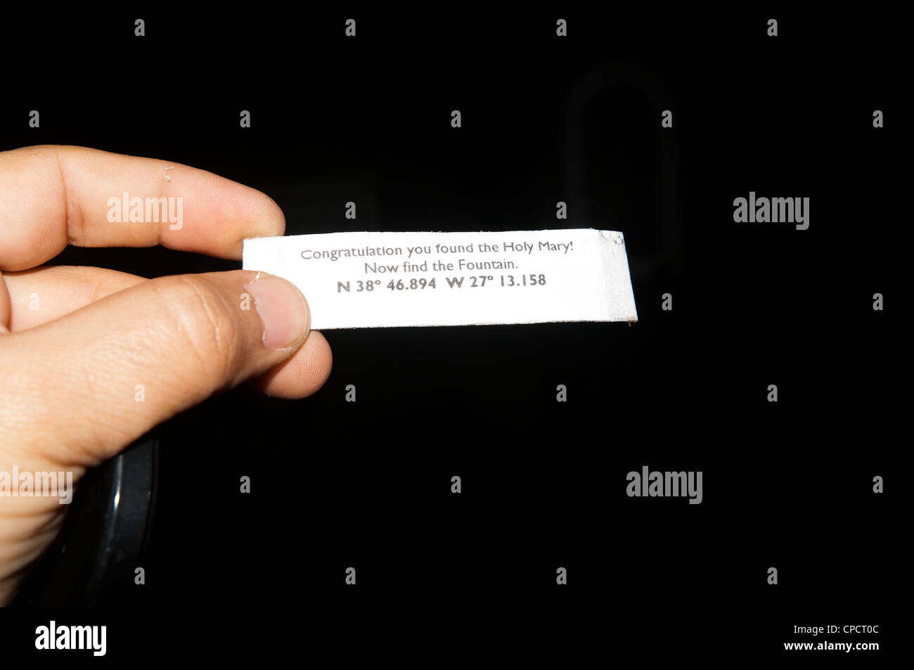 Geocaching reference hint on stage of multi cache - Stock Image