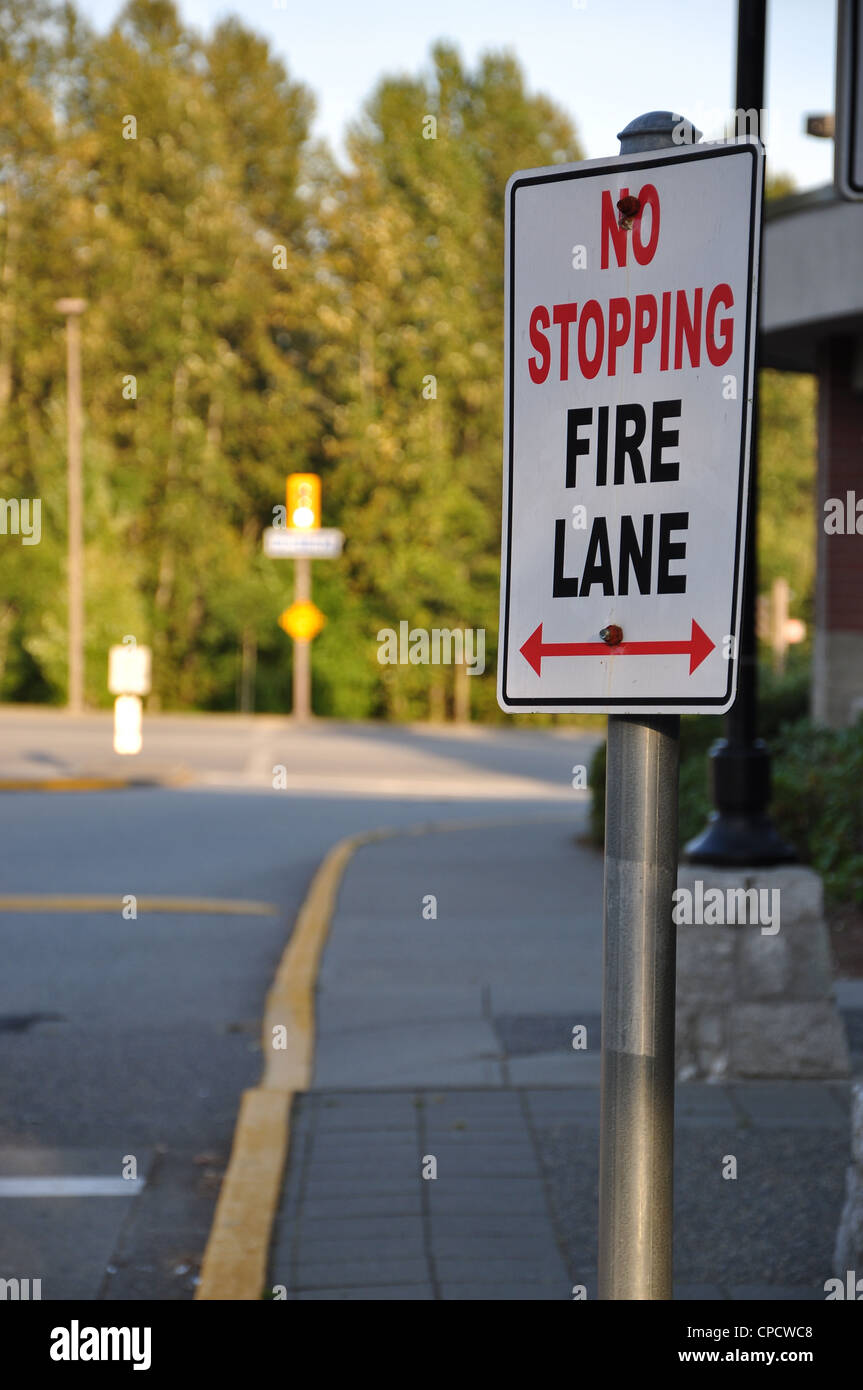 No stopping on fire lane sign - Stock Image