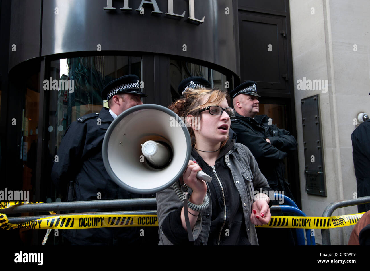 British Bankers' Association .Young woman from Occupy Movement with megaphone - Stock Image