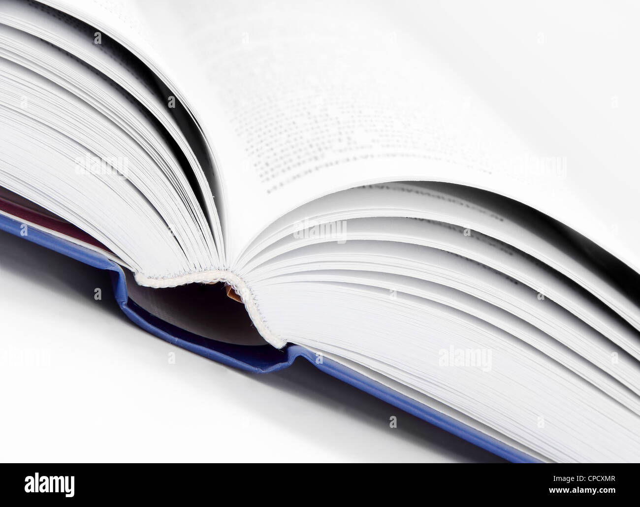 Close Up Open Book in White and Blue - Stock Image