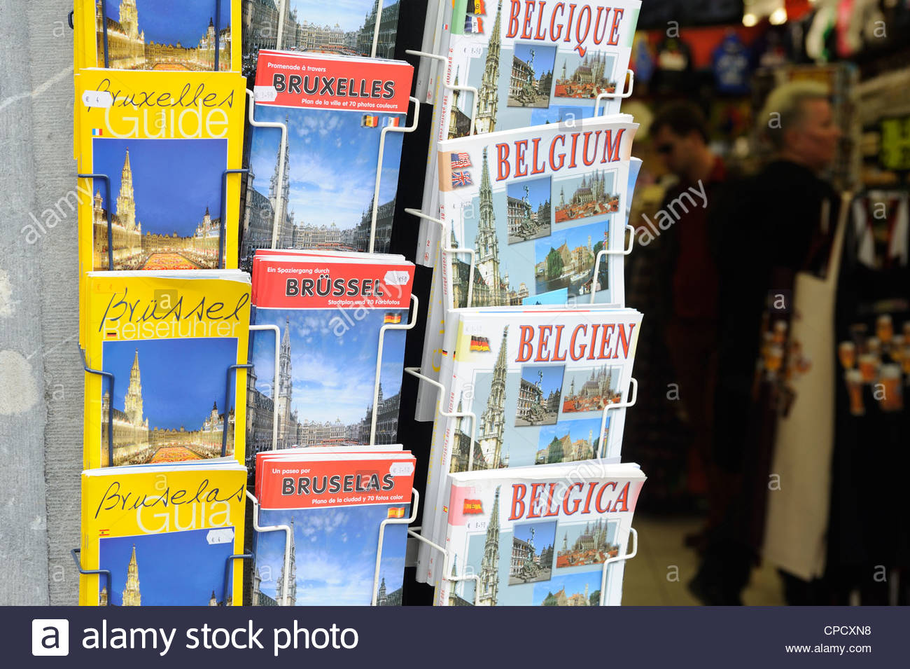 Brussels, Belgium Travel guides in many languages in a souvenir shop. - Stock Image