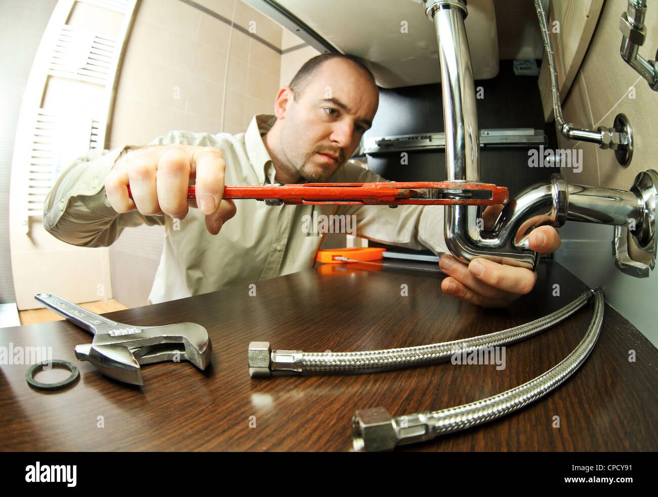 portrait of caucasian plumber at work - Stock Image