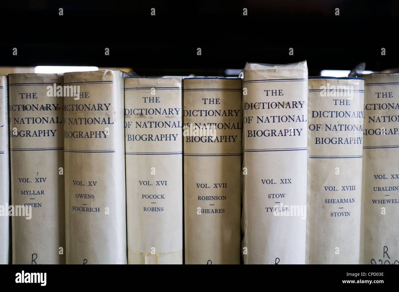 Copies of the Dictionary of National Biography books in the reference section of a public library, UK - Stock Image