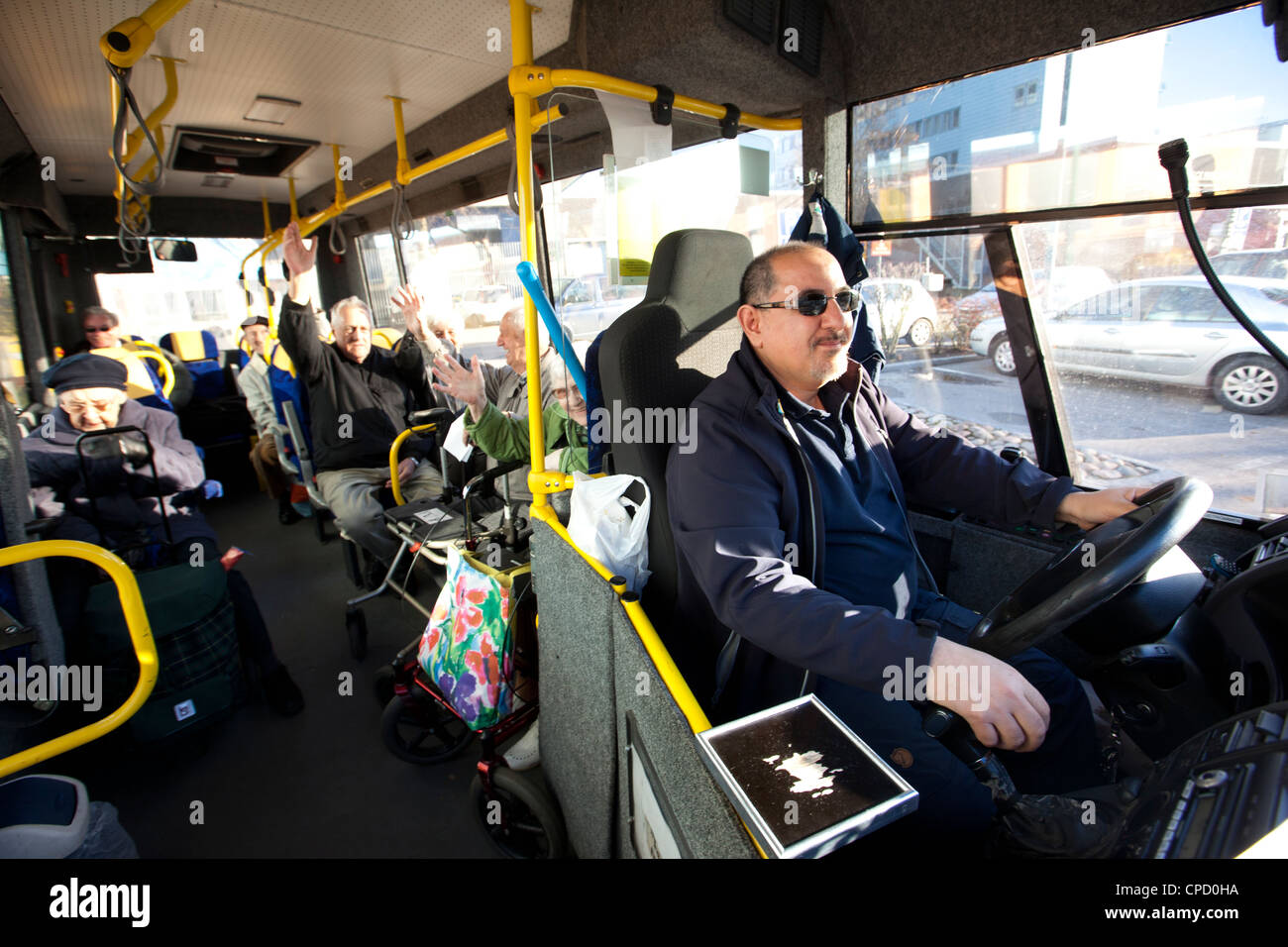 Bus driver with passengers - Stock Image