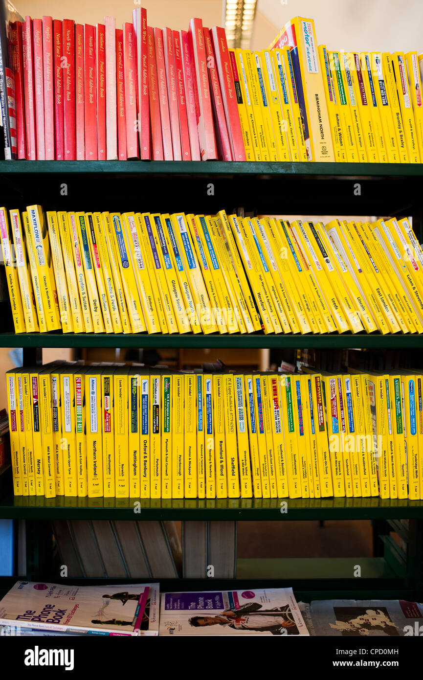 yellow pages phone books in the reference section of a public library uk stock