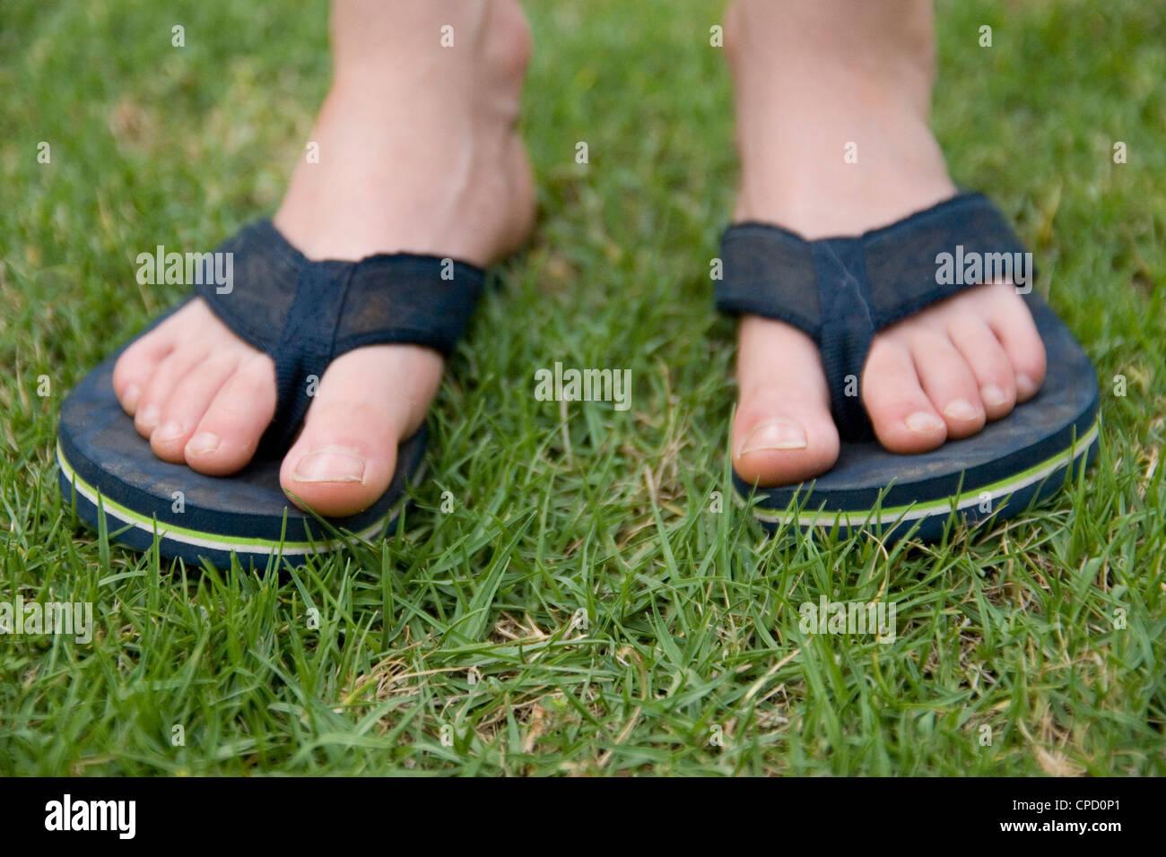 5f84340f84e16 Feet In Flip Flops Stock Photos   Feet In Flip Flops Stock Images ...