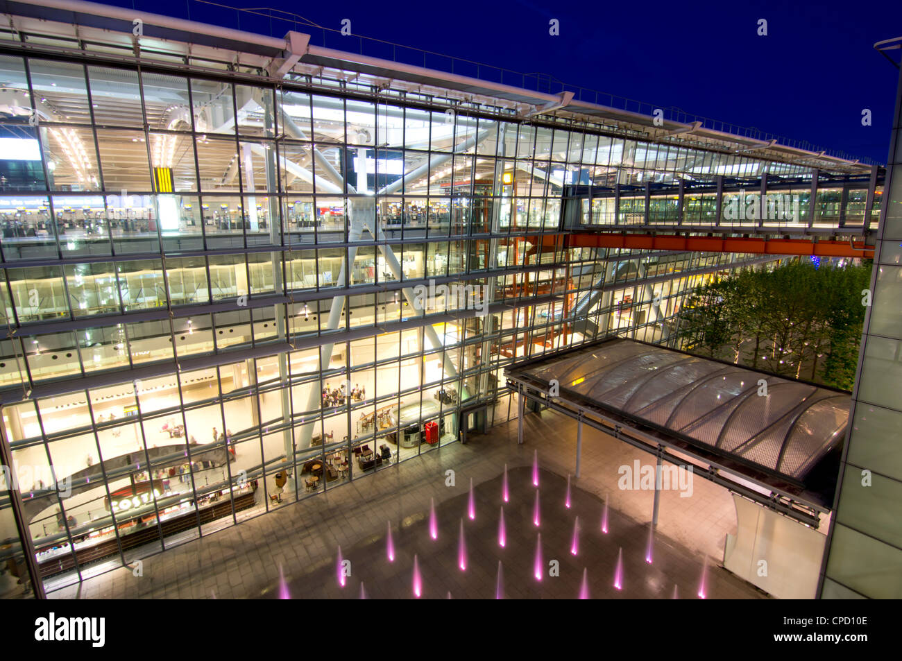 Heathrow Airport Terminal 5 building at dusk, London, England, United Kingdom, Europe - Stock Image