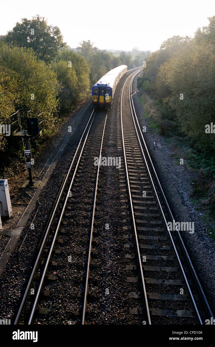 Double railway tracks, Surrey, England, United Kingdom, Europe - Stock Image