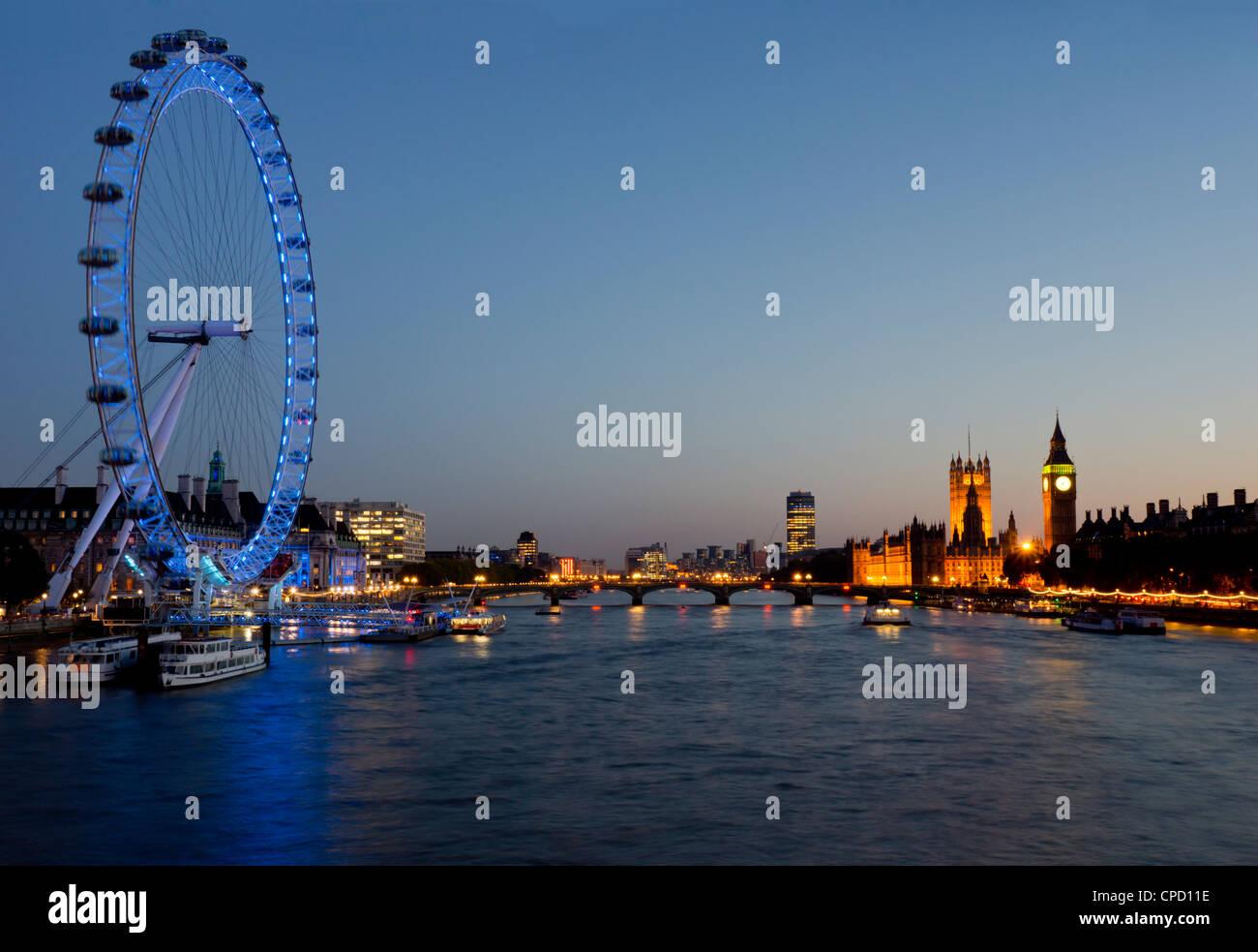 Houses of Parliament, Westminster and London Eye at dusk, London, England, United Kingdom, Europe - Stock Image