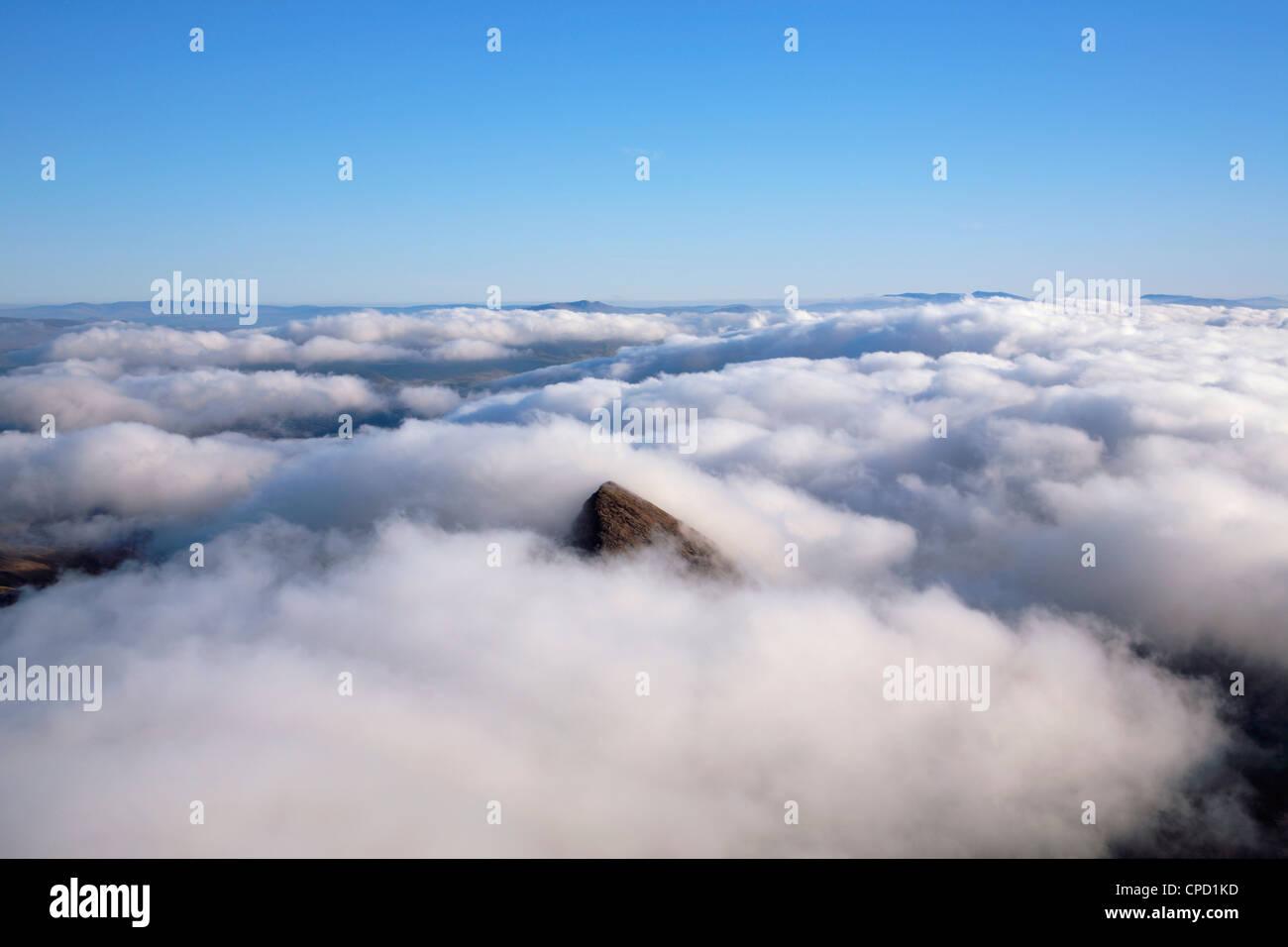 Peak of Y Lliwedd poking through the cloud from the summit of Mt Snowdon (Yr Wyddfa). Snowdonia National Park. Gwynedd. Wales Stock Photo