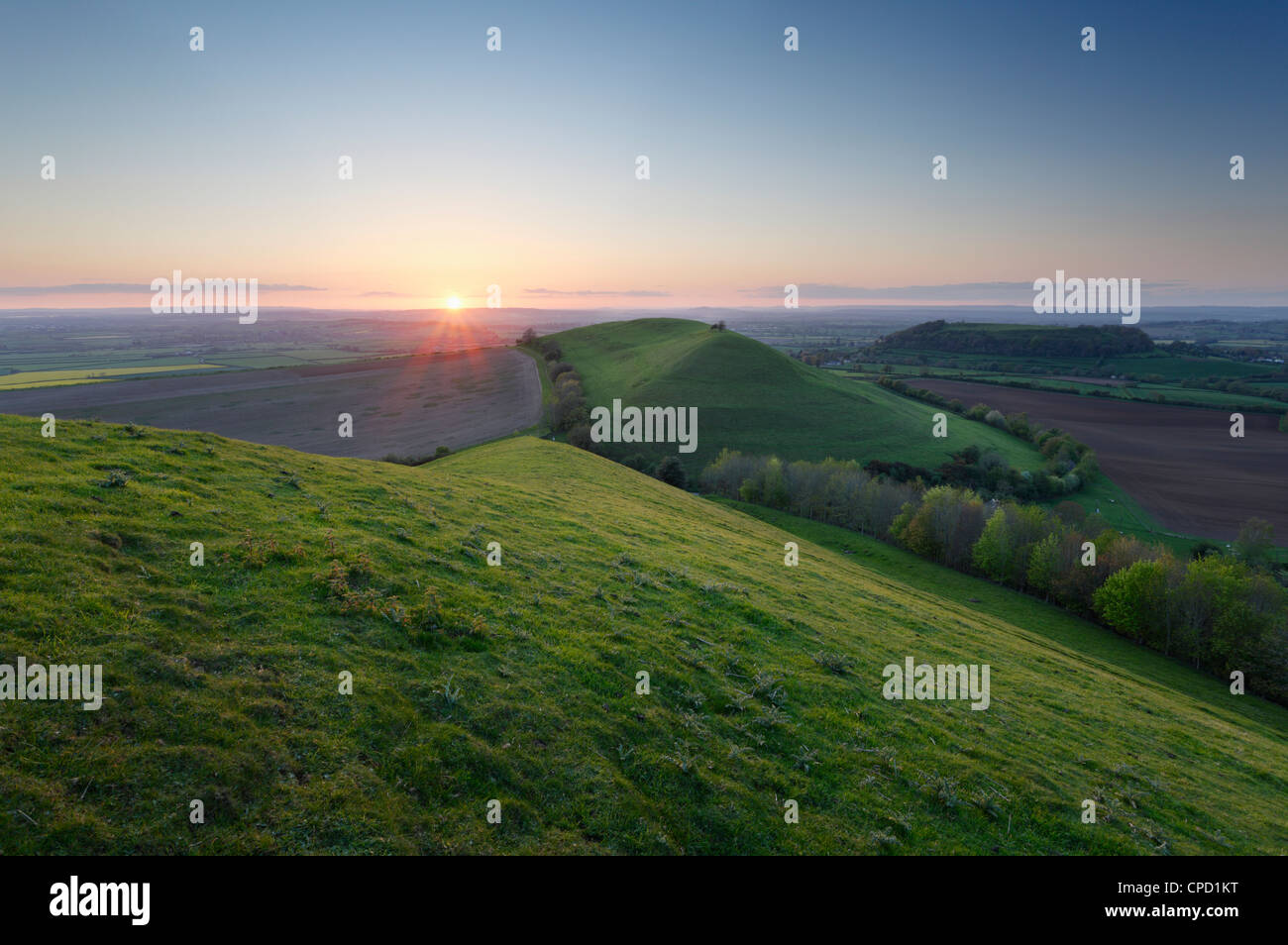 View from Corton Hill towards Parrock Hill and Cadbury Castle, Sunset. Somerset. England. UK. - Stock Image