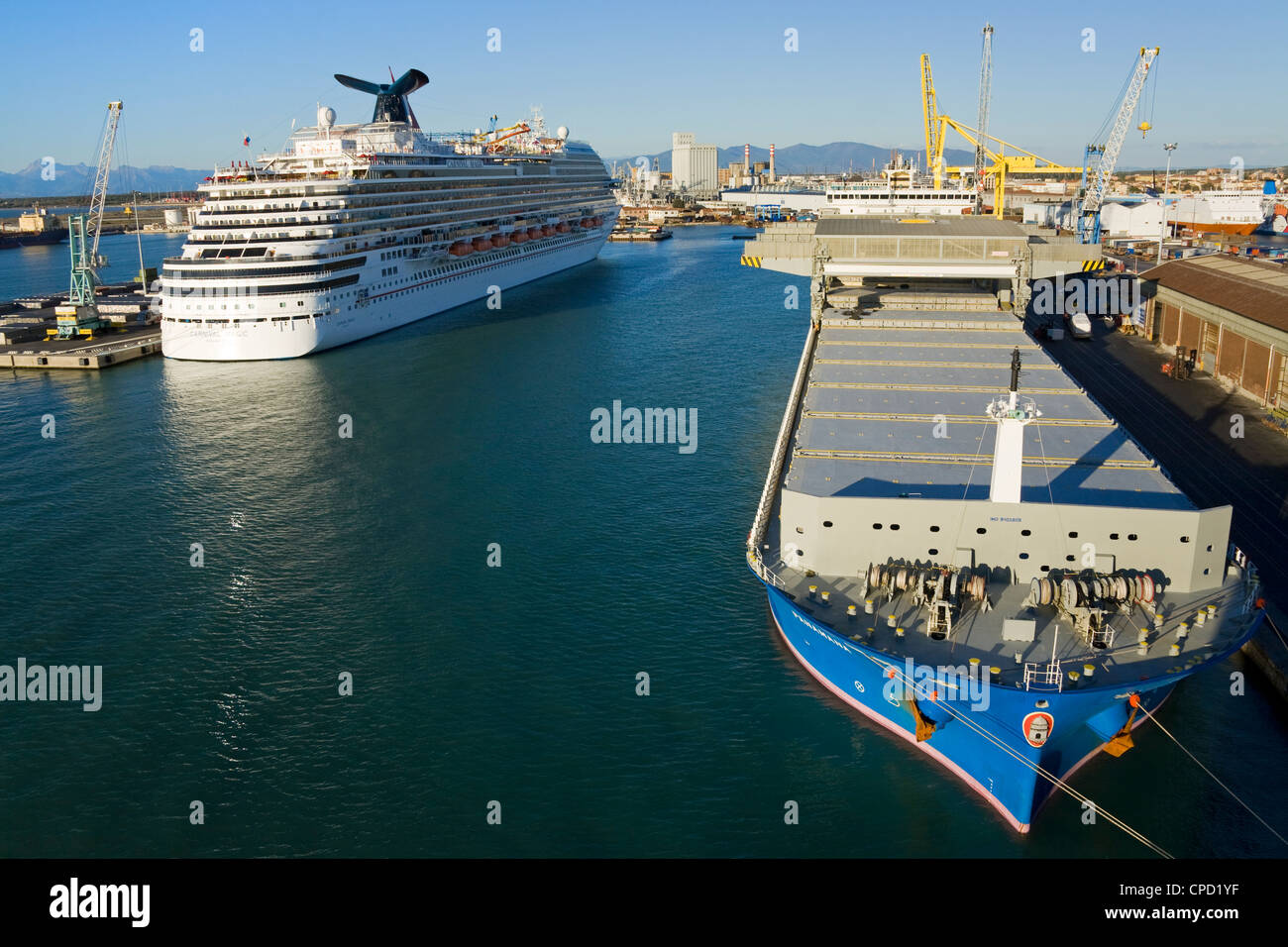 Cargo and cruise ship in the Port of Livorno, Tuscany, Italy, Europe - Stock Image