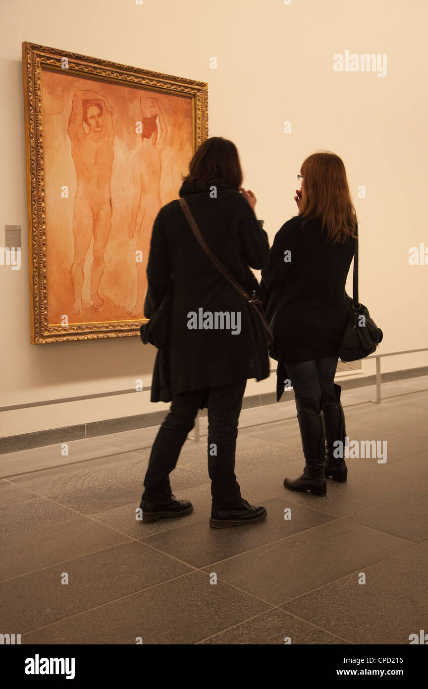 Two young ladies admiring a Picasso painting in the Orangerie Gallery, Paris, France, Europe - Stock Image