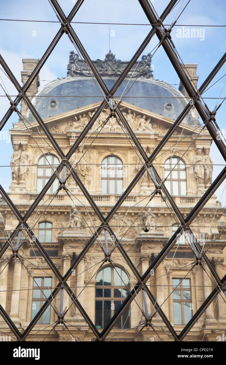 The Louvre viewed through the Pyramid, Paris, France, Europe - Stock Image