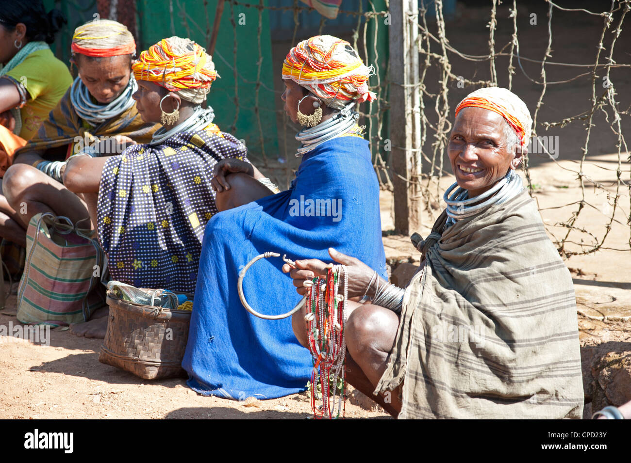 Bonda tribeswomen in traditional dress with beaded caps, Rayagader, Orissa, India - Stock Image