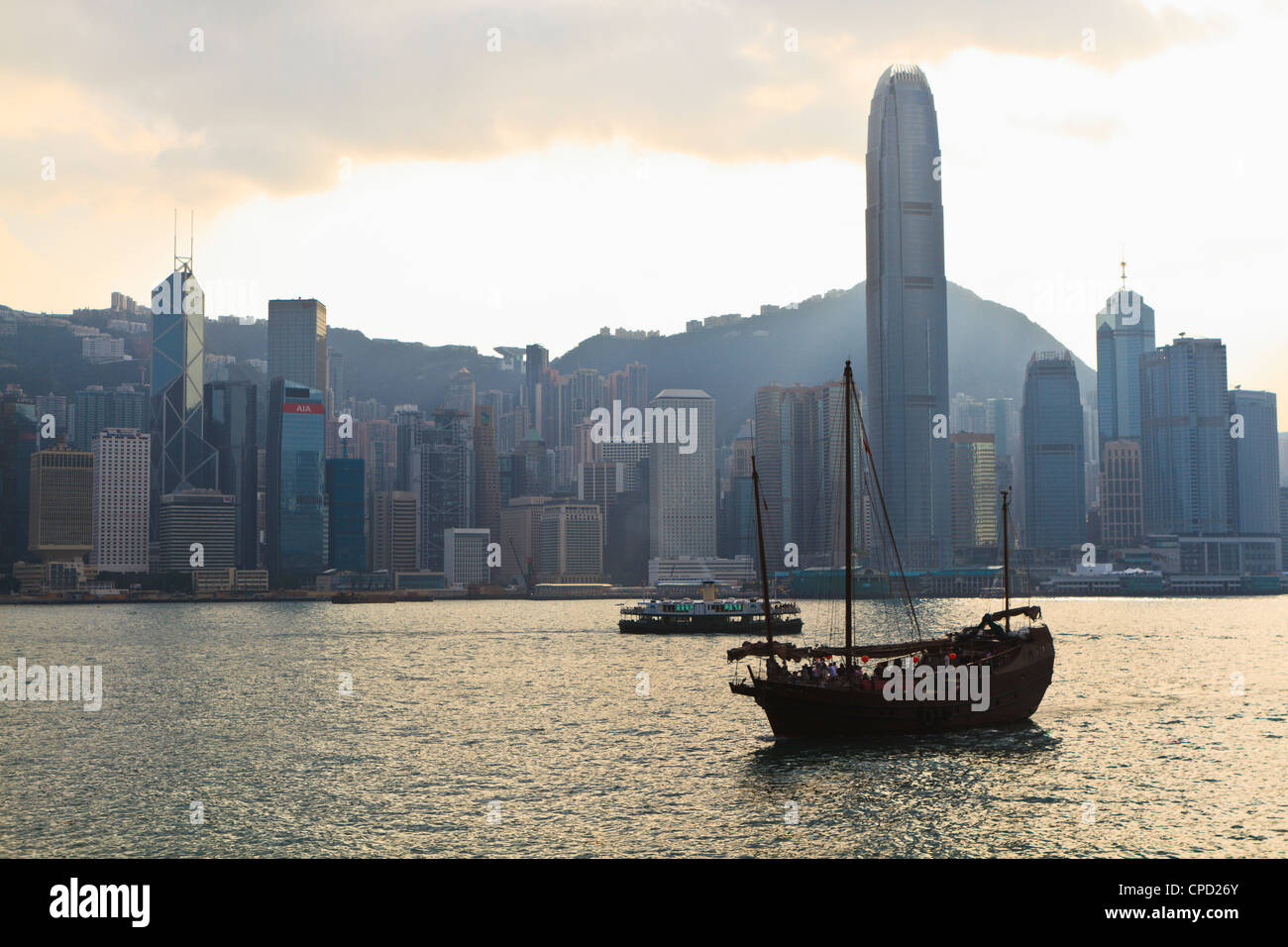 Star Ferry crossing Victoria Harbour towards Hong Kong Island, Two IFC Tower on the right, Hong Kong, China, Asis Stock Photo
