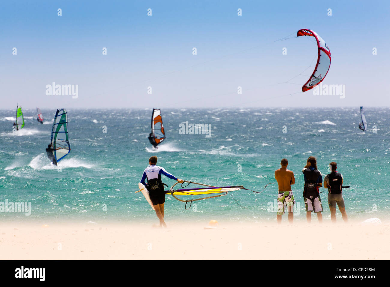 Spectators watching windsurfing in high Levante winds in the Strait of Gibraltar, Valdevaqueros, Tarifa, Andalucia, - Stock Image