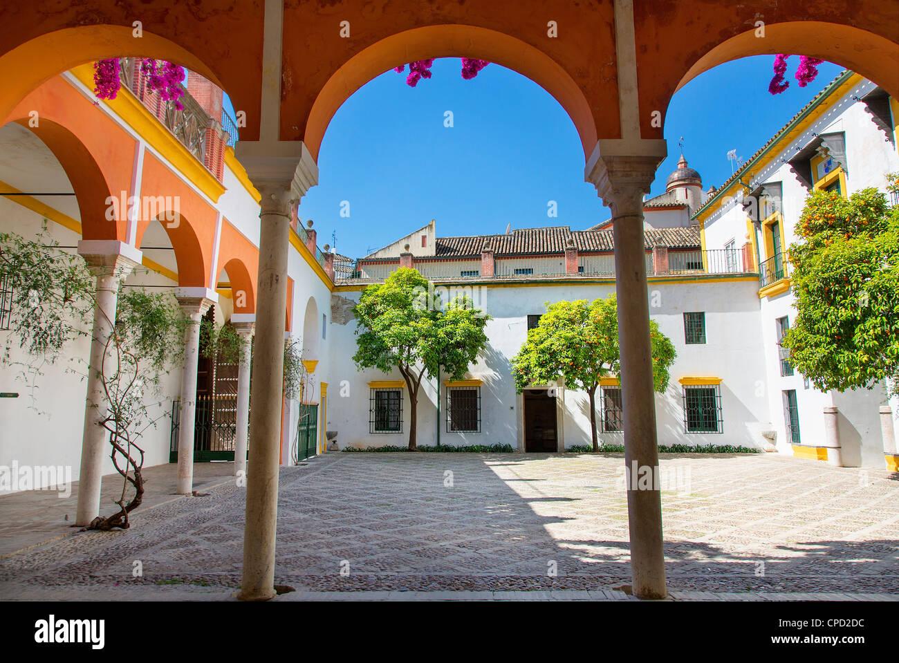 Europe, Spain Andalusia, Sevilla, Courtyard in Casa de Pilatos - Stock Image