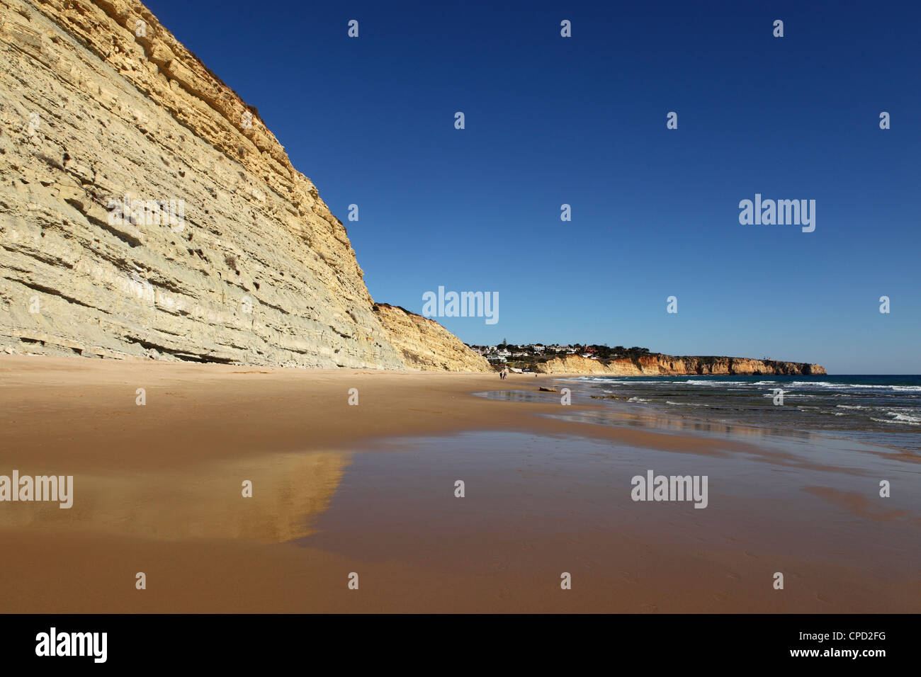 Golden sands and steep stratified cliffs, typical of the Atlantic coastline near Lagos, Algarve, Portugal, Europe - Stock Image