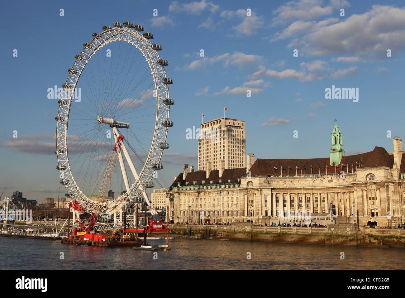 County Hall, home of the London Aquarium, and the London Eye on the South Bank of the River Thames, London, England, - Stock Image