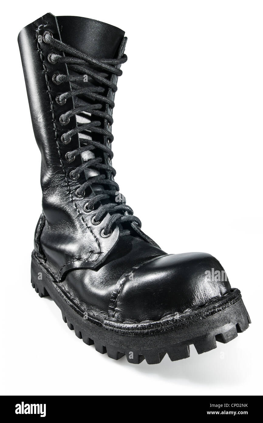 Close-up on the black, shiny, hand made army boot. - Stock Image