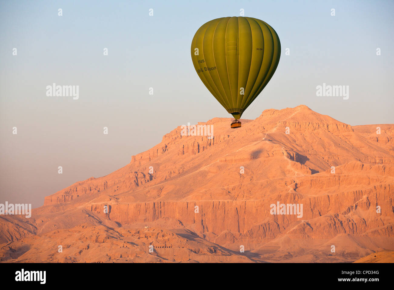 Hot air balloon suspended over the Theban hills of Luxor, Thebes, Egypt, North Africa, Africa - Stock Image
