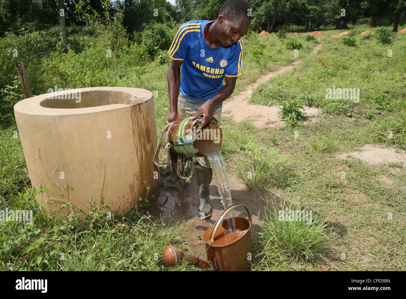 Man fetching water from well, Tori, Benin, West Africa, Africa - Stock Image