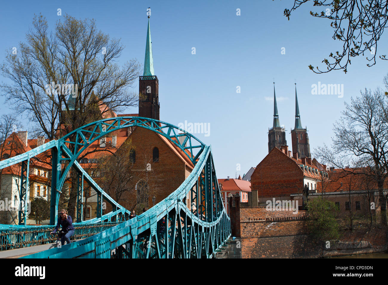 Tumski Bridge, Cathedral of St John Baptist and Church of the Holy Cross on Ostrow Tumski island in Wroclaw, Poland. Stock Photo