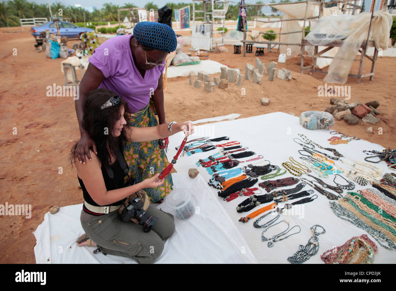 Woman buying souvenirs, Ouidah, Benin, West Africa, Africa - Stock Image