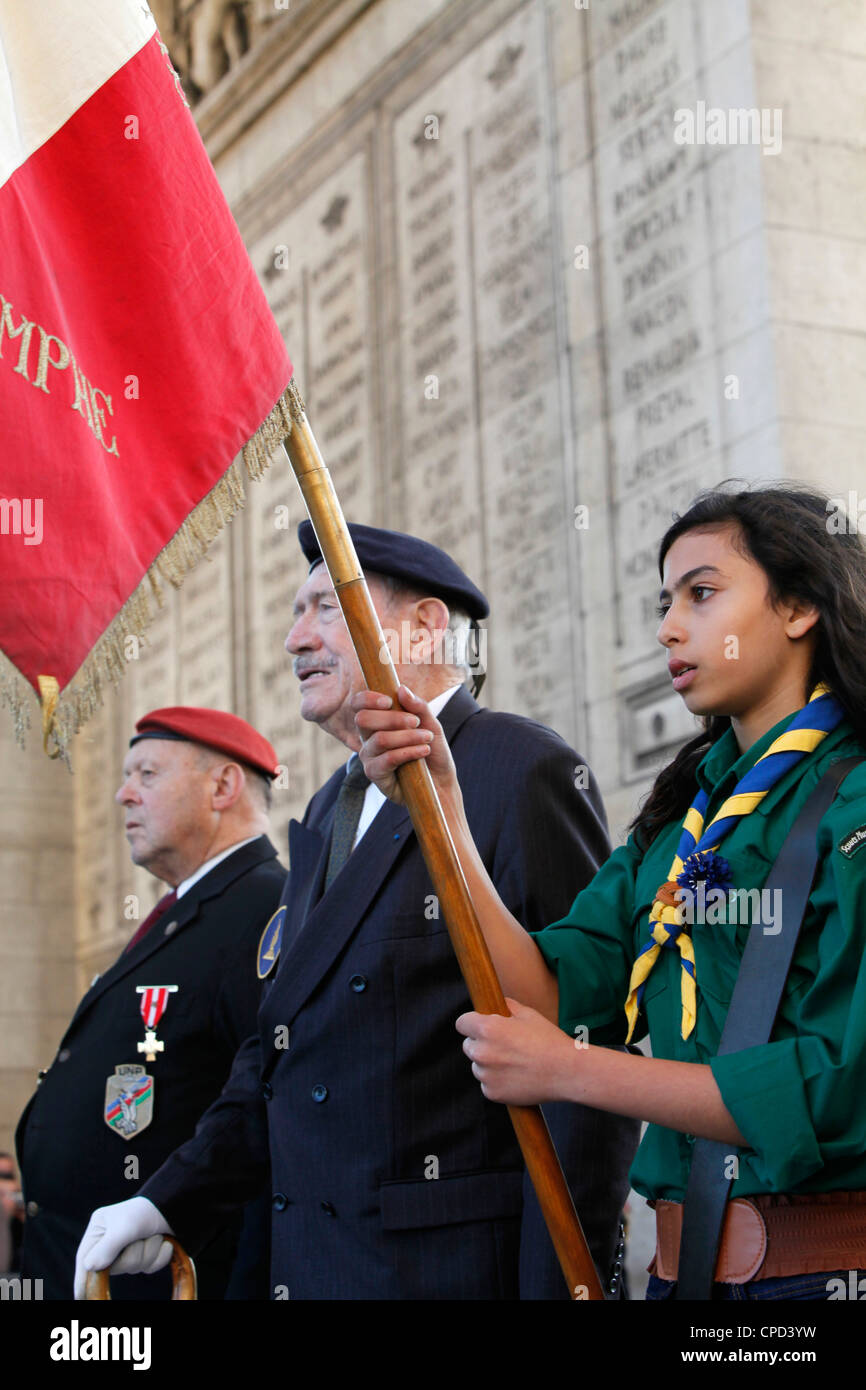 French Muslim girl scout and war veterans at the Arc de Triomphe, Paris, France, Europe - Stock Image