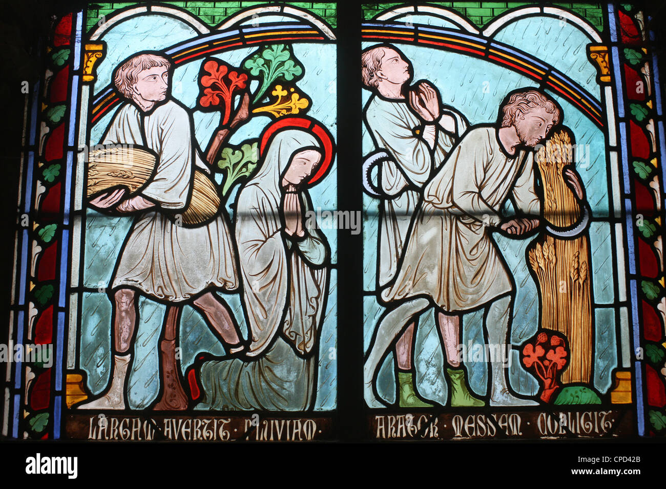 Stained glass depicting Sainte Genevieve's life, cloister of Notre-Dame de Paris cathedral, Paris, France, Europe - Stock Image