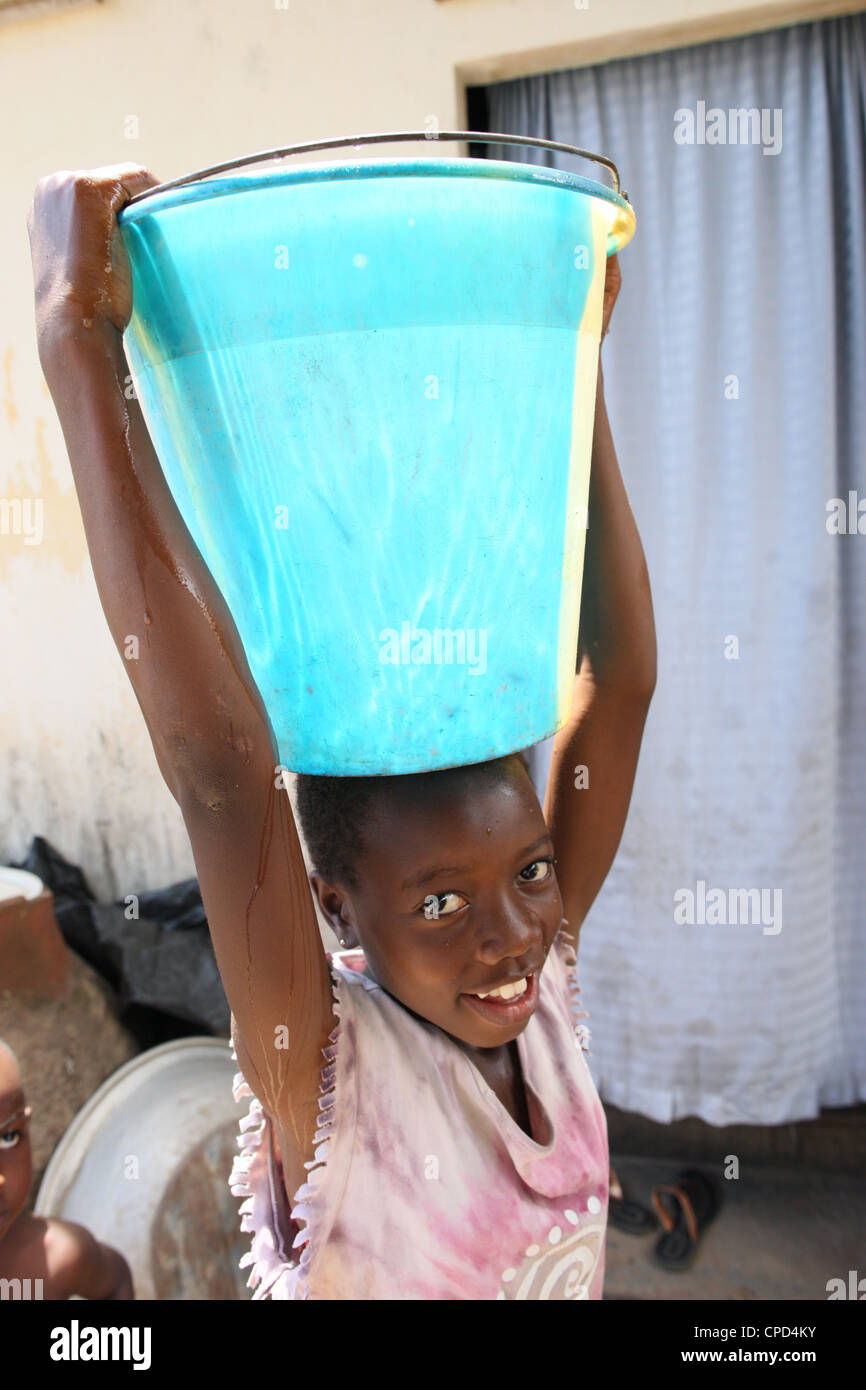 African child sponsored by an NGO, Lome, Togo, West Africa, Africa - Stock Image