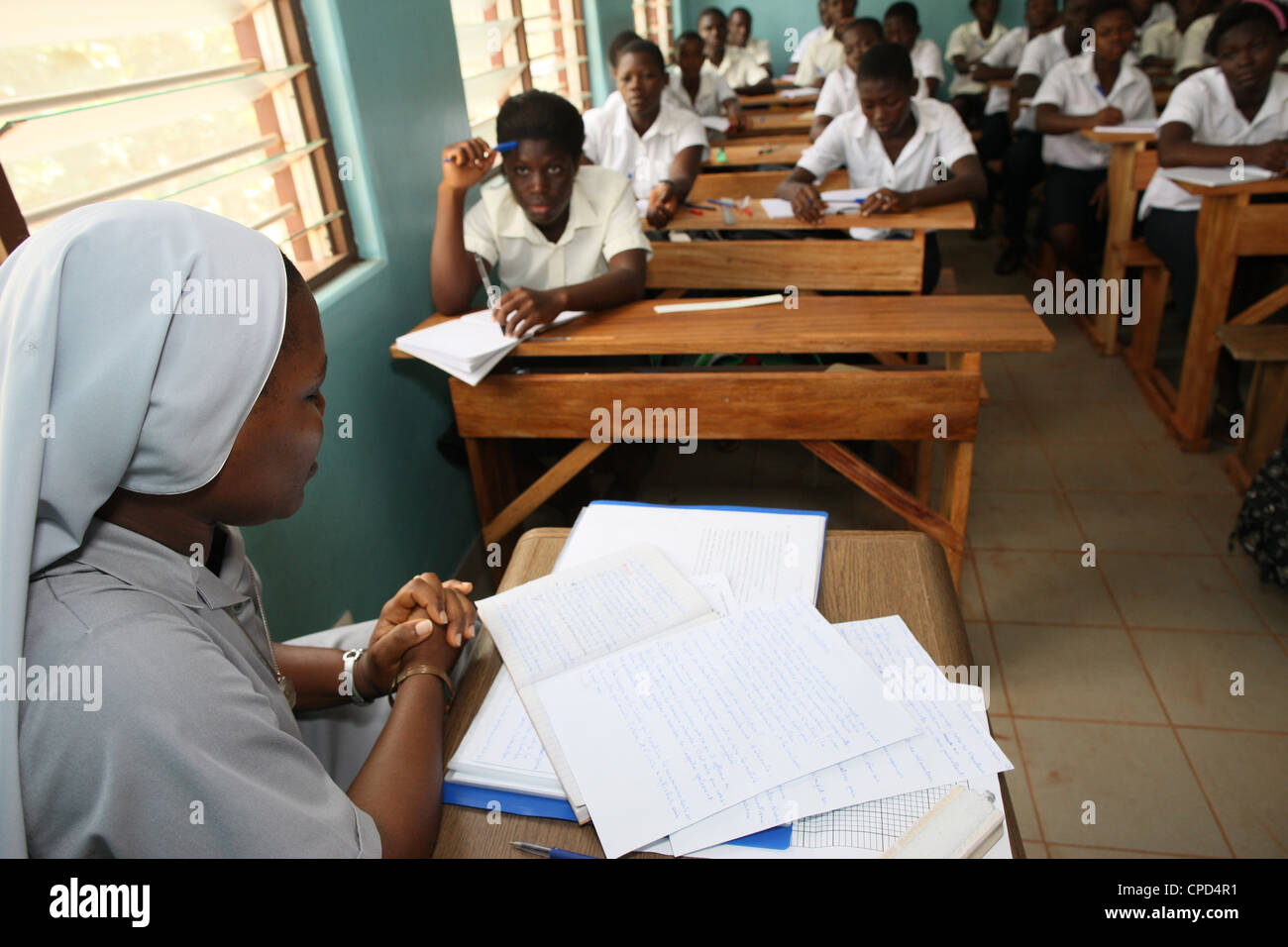 Catholic nun teaching in a secondary school, Lome, Togo, West Africa, Africa - Stock Image