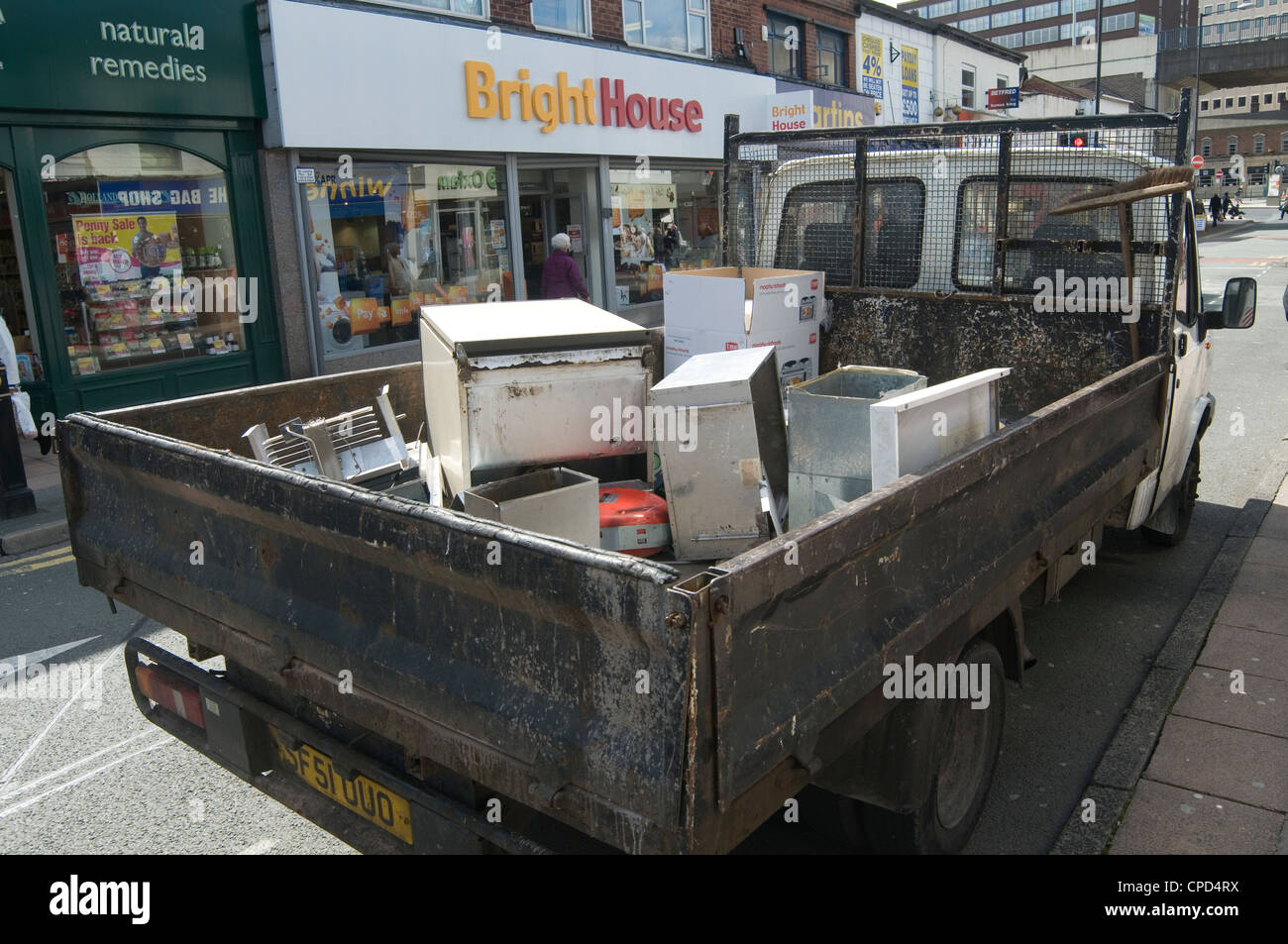 rag and bone man van loaded with scrap metal old appliances recycling recyle recycling - Stock Image