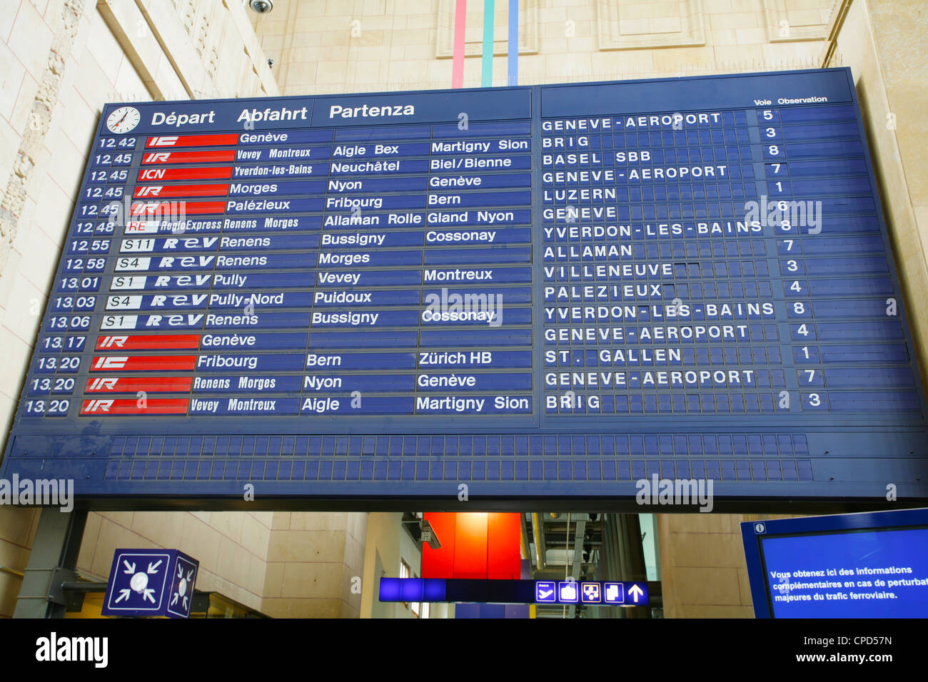 Board schedules of trains and arrives at the station - Stock Image