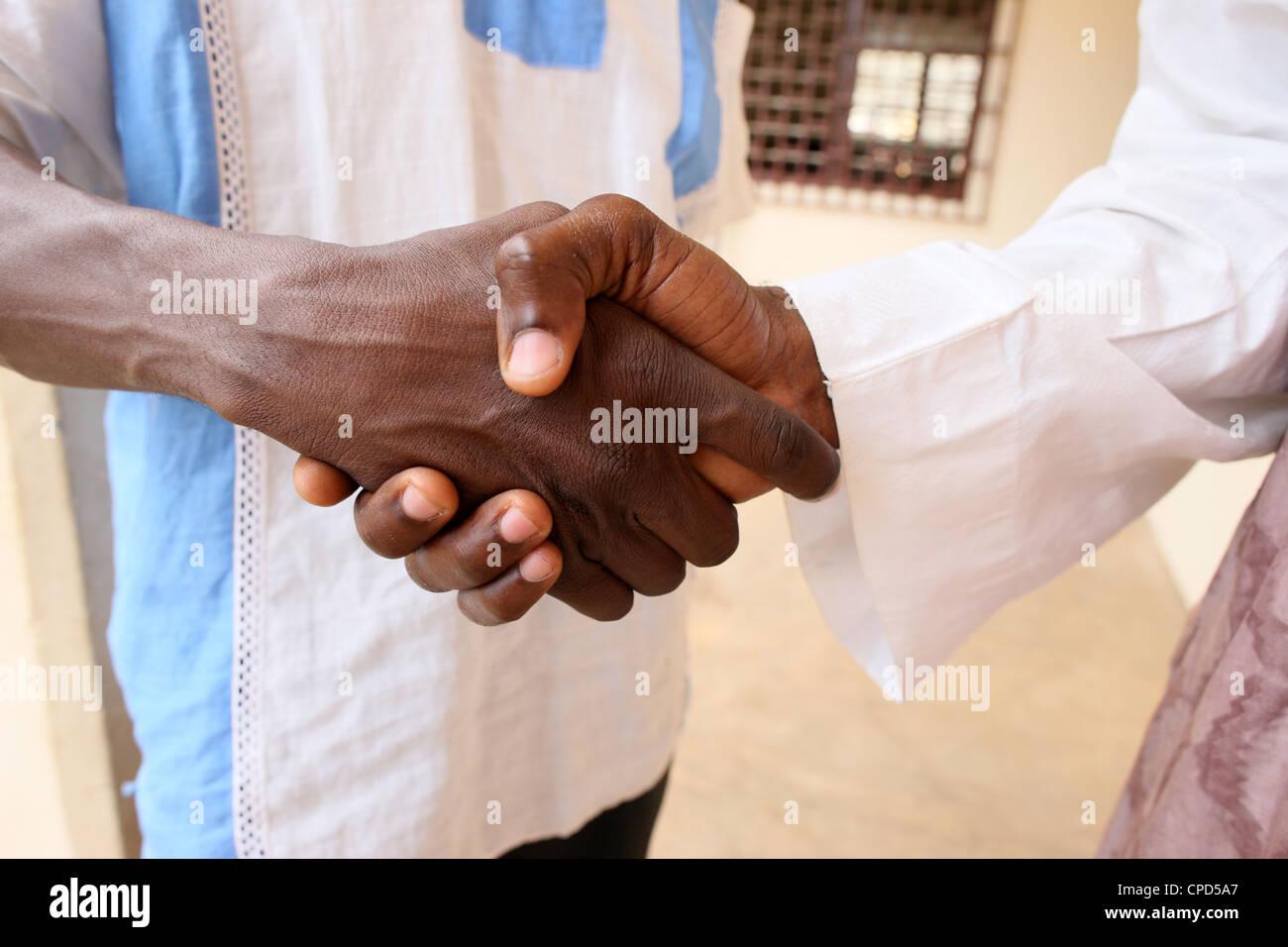 Handshake, Lome, Togo, West Africa, Africa - Stock Image