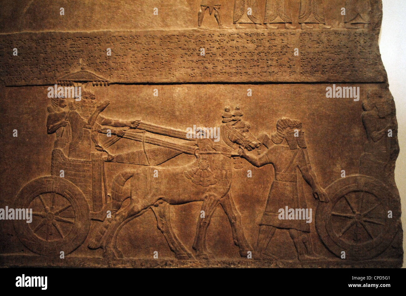 Alabaster panel depicting King Tiglath-Pileser III in his chariot. From the Palace of Nimrud. Stock Photo