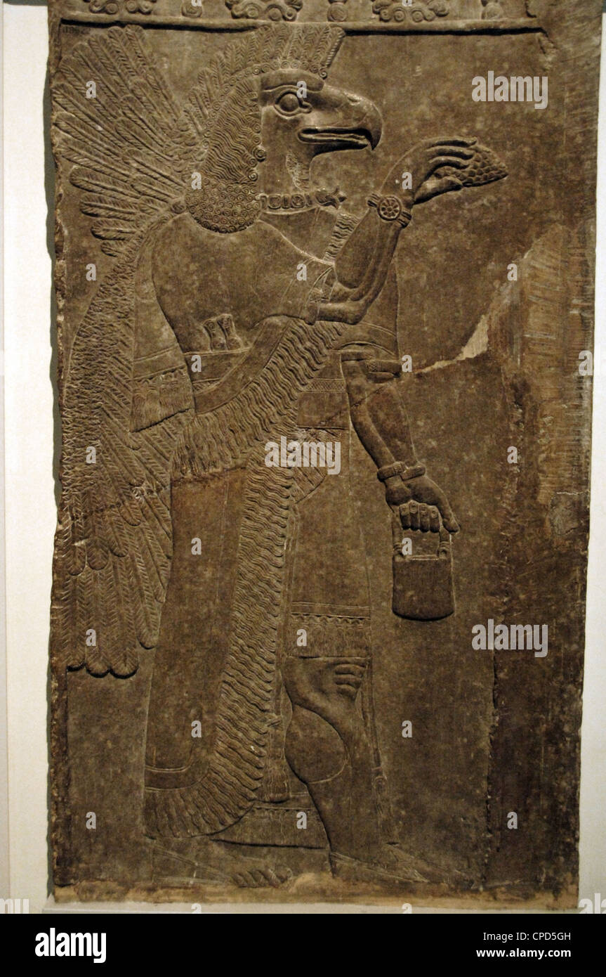 Relief depicting a Eagle-headed protective spirit. 865-860 BC. From the Temple of Ninurta. Nimrud. Stock Photo