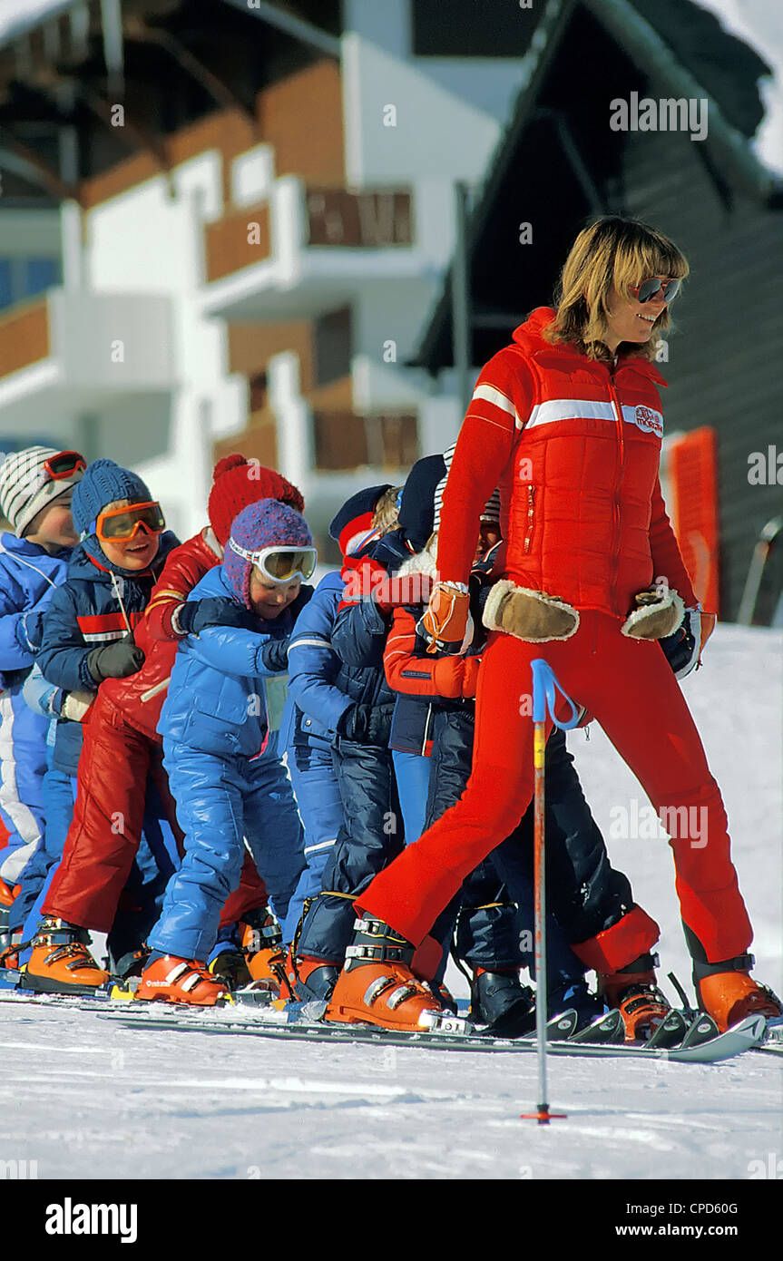 Kindergarten Ski Class with a Swiss Ski Instructor at Morgins, Switzerland. - Stock Image