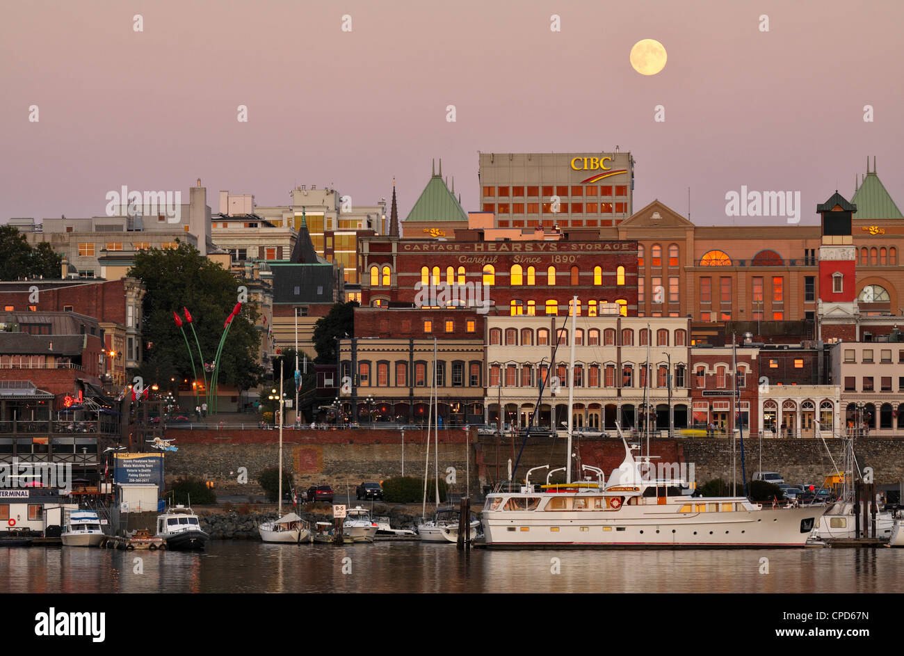 Full moon rising over Victoria city skyline-Victoria, British Columbia, Canada. - Stock Image